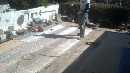Metal lath being stapled down first.