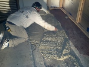 Filling in floor area between new and old with Rapid-Set cement
