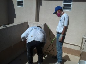 Applying a texture coat to reduce slip and fall hazards.