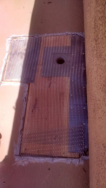 New drain installed and lath ready to be stapled down.